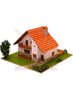 Casa de ladrillos con jardin