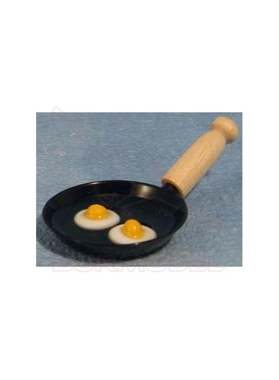 Sartén con huevos fritos
