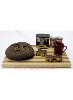 Tabla con moldes y pasteles